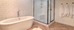 Elegant bathroom with bathtub and black framed shower