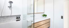 Elegant bathroom featuring frameless shower enclosure