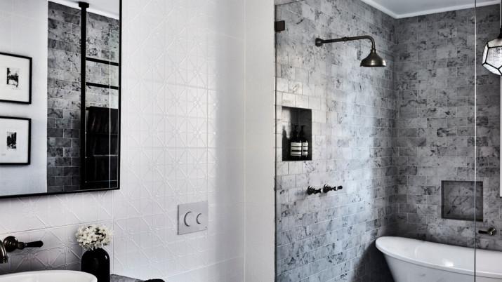 Modern bathroom featuring semi-frameless shower enclosure with bath